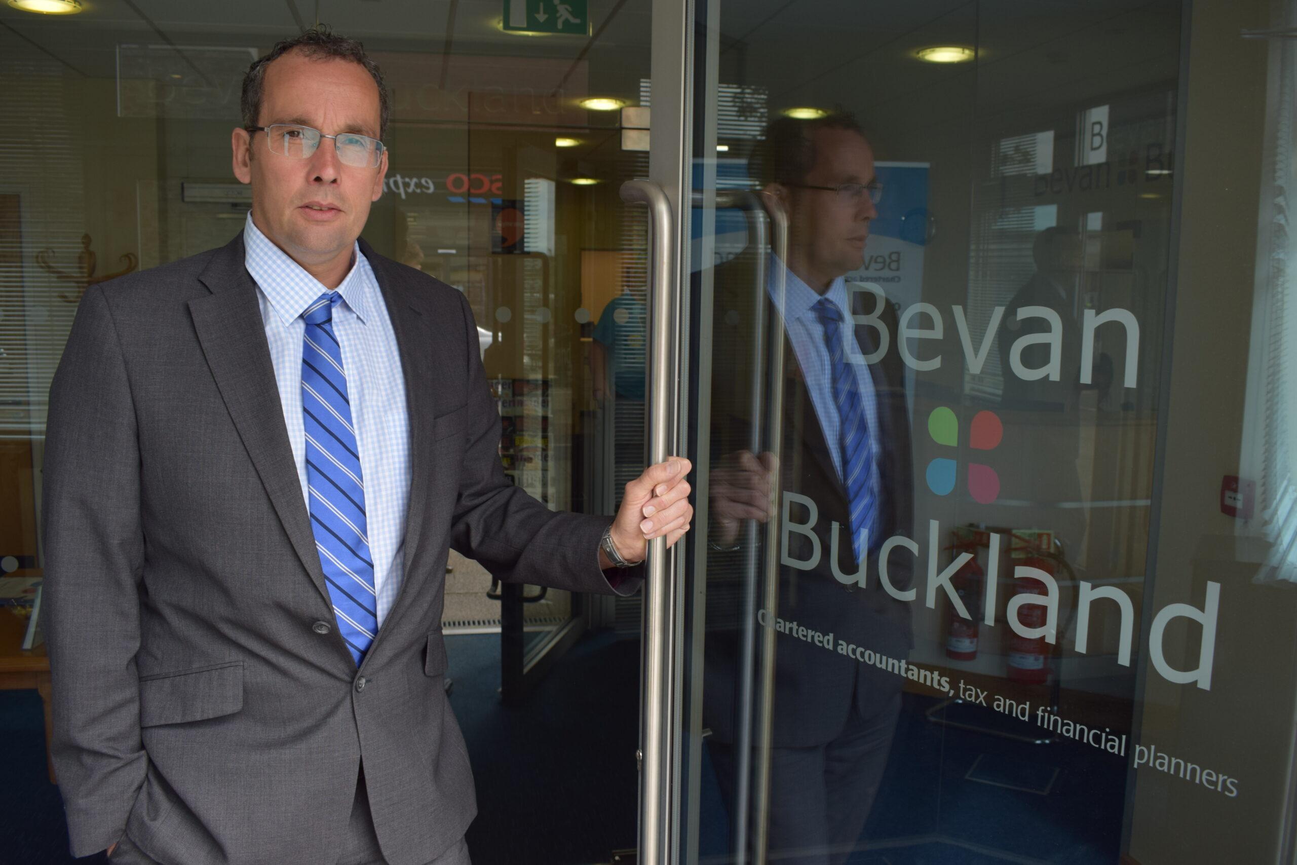 Paul Arnold holding the front door of Bevan Buckland LLP