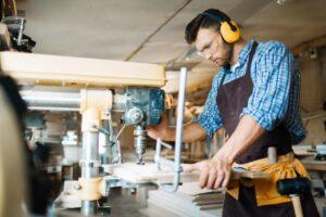 Carpenter using a machine