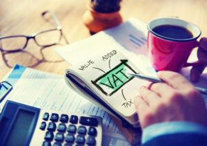 VAT written on a writing pad