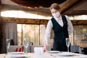 waitress laying table