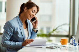 Female office worker on mobile phone